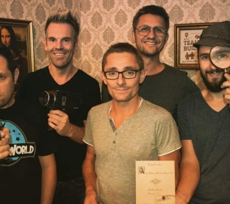 The original founders team showing certificate of completion of an escape room