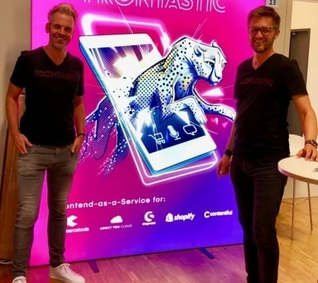 Henning and Thomas in front of a large Frontastic banner during K5 2018