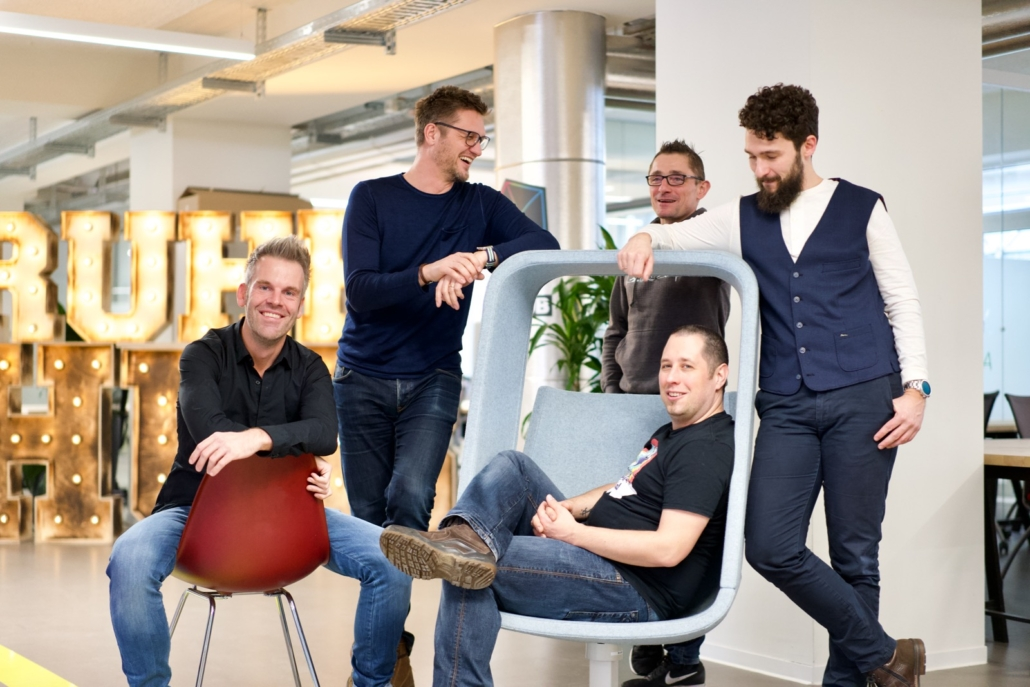 Frontastic Founders Team sitting in co-working space