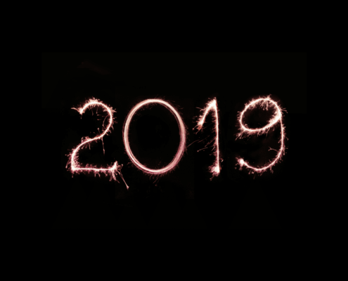 photo of the number 2019 written in dark skiy with flash light